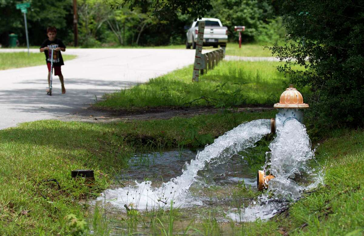 Water from a fire hydrant flows toward Little Caney Creek after a pump failure from a Conroe sewage collection facility along South Loop 336 East on July 8 caused an estimated one million gallons to overflow from the sewer.