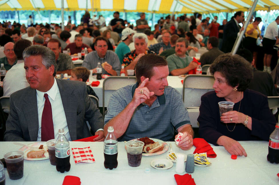 From left, Albany City Mayor Jerry Jennings, New York Giants head coach Jim Fassel and University of Albany President Karen Hitchcock all enjoy a lunch break at the Giants media Day at the University, Friday, July 21, 2000. (Times Union Staff Photo by STEVE JACOBS)