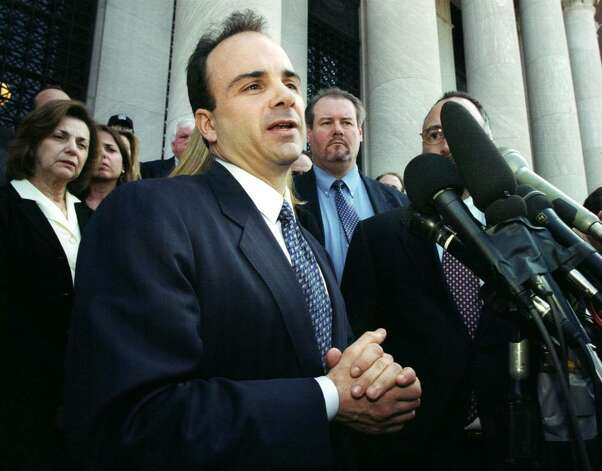 Mayor Joseph Ganim makes a brief statement in front of  U.S. District Court in New Haven, Conn.,Wednesday, March 19, 2003, after he was found guilty on 16 of 21 federal corruption charges. Photo: Ned Gerard / Connecticut Post