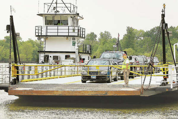 The Brussels Ferry, operated by the Illinois Department of Transportation, pulls up to the Jersey County side of the Illinois River Tuesday after bringing motorists from Calhoun County across the river. After this year's near record river levels, residents are trying to secure flood-proof access in and out of Calhoun County.