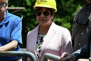 Colonie Town Supervisor Paula Mahan is given a tour of the Schuylerville Hydroelectric Facility on Tuesday, July 9, 2019, in Schuylerville, N.Y. Under an innovative mechanism known as remote net metering, Colonie has agreed to a 20-year power purchase agreement with Gravity Renewables, Inc. for power produced at a Schuylerville hydroelectric facility owned and operated by Brookfield Renewable.(Will Waldron/Times Union)