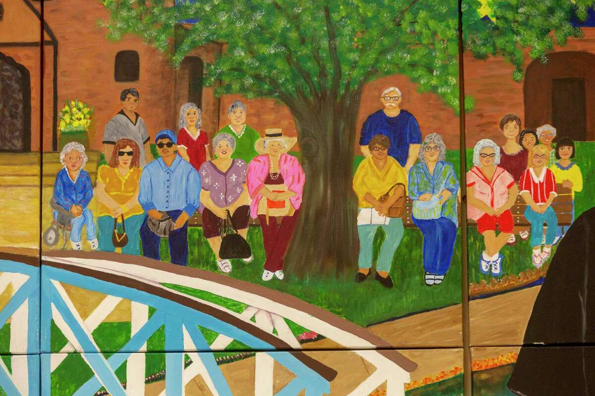 """""""South Side Pride,"""" a mural painted by students in an art class at the Elvira Cisneros Senior Center, includes a self portrait of the artists. The mural is made up of 87 panels and shows the city's past, present and future."""