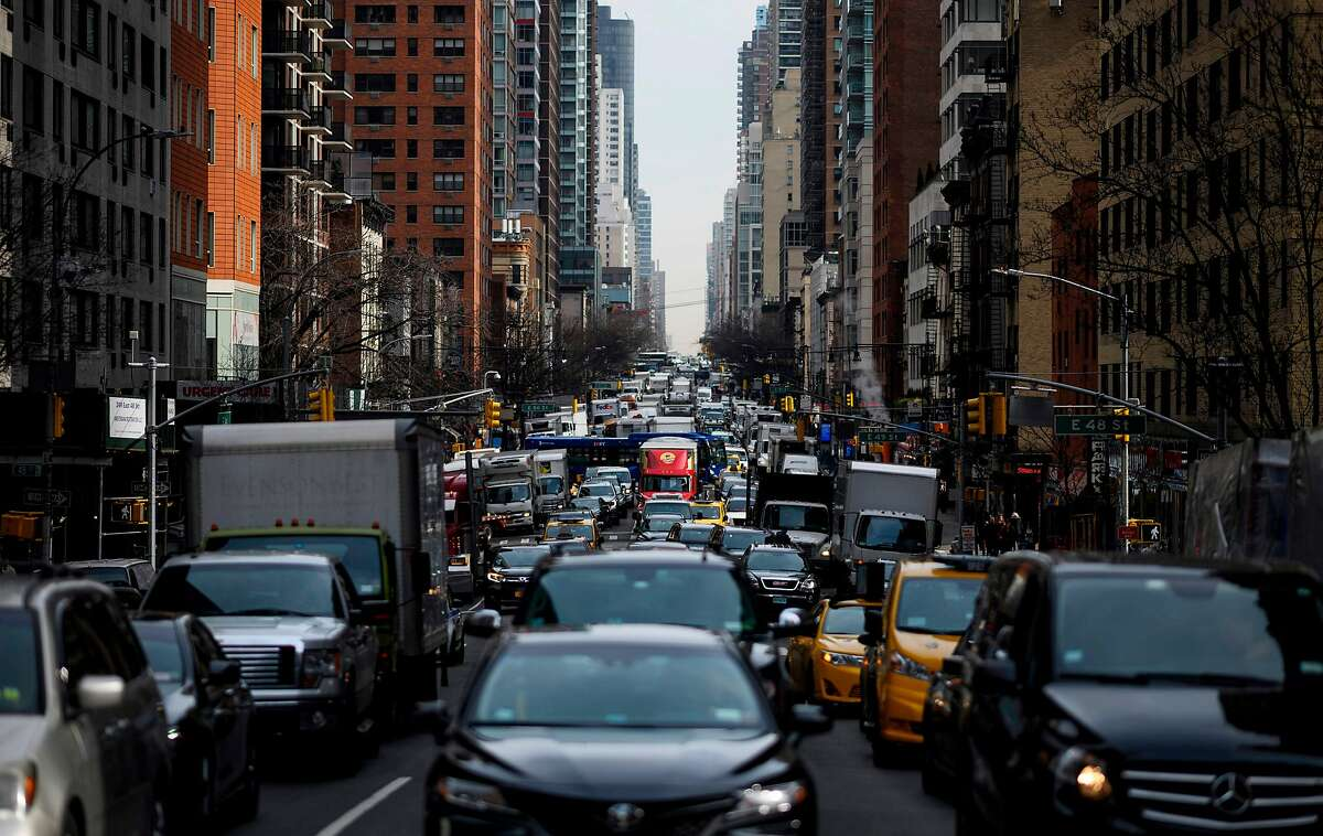 """(FILES) In this file photo taken on March 15, 2019 traffic moves on 2nd Avenue in the morning hours in New York City. - New York State on June 17, 2019 passed a law allowing undocumented migrants to obtain their driving license, a controversial move by the Democratic stronghold intended to thwart the Trump administration's restrictive immigration policy. """"This legislation will not only provide undocumented immigrants with a legal solution to obtain a driver's license, but its positive impacts will include significant economic growth, improved road safety, and it will keep hardworking families together,"""" Senator Luis Sepulveda, one of its leading proponents, said in a statement. (Photo by Johannes EISELE / AFP)JOHANNES EISELE/AFP/Getty Images"""