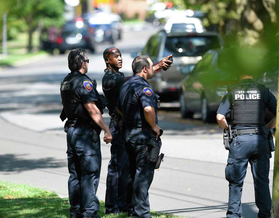 Stamford Police investigate the scene of an East Side neighborhood on Seaton Road near Courtland Avenue in Stamford, Conn. on July 9, 2019 on a report of shots fired. According to police scanner reports, two suspects were taken into custody at the scene. Photo: Matthew Brown / Hearst Connecticut Media / Stamford Advocate