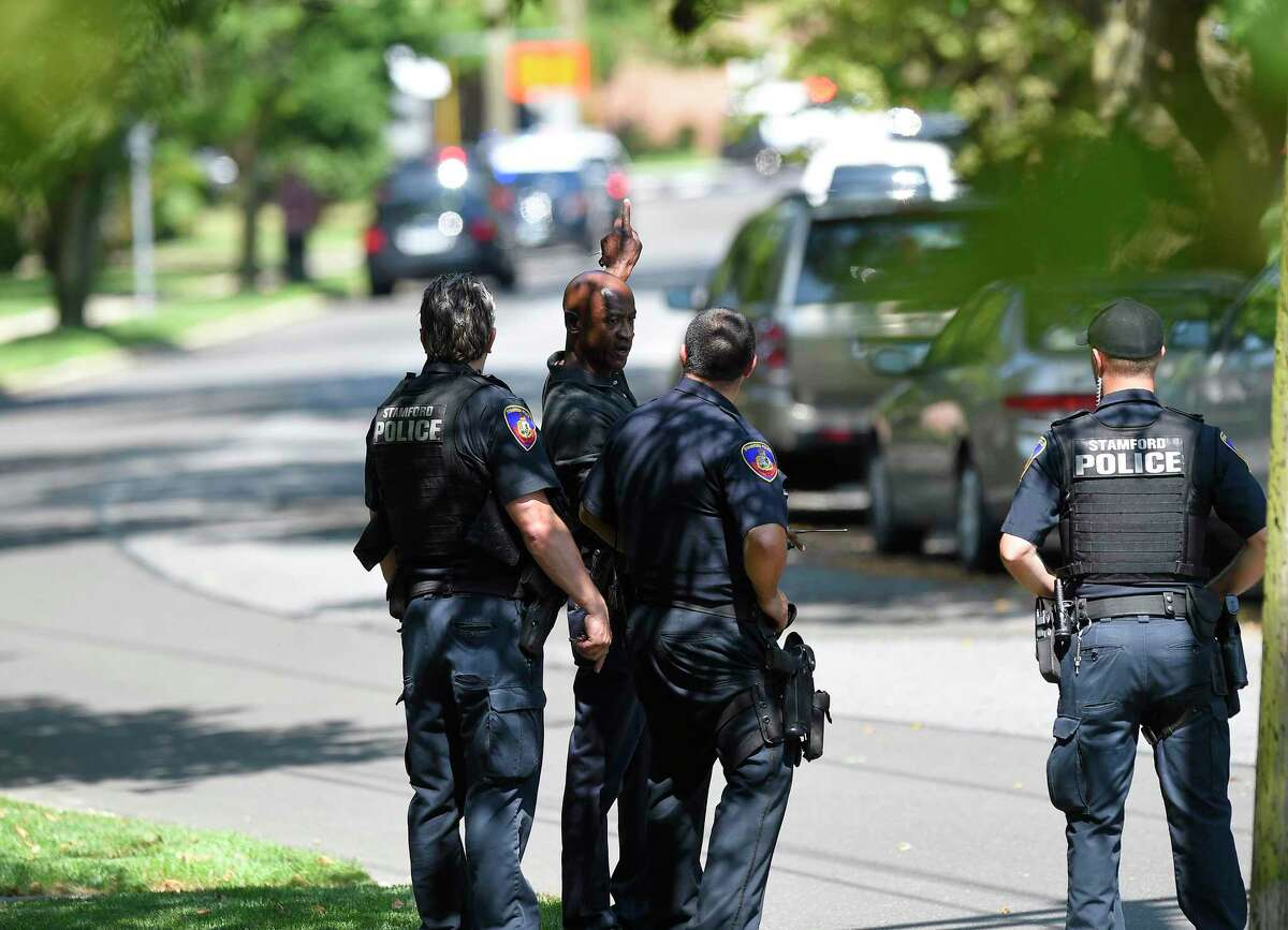 Stamford Police investigate the scene of an East Side neighborhood on Seaton Road near Courtland Avenue in Stamford, Conn. on July 9, 2019 on a report of shots fired. According to police scanner reports, two suspects were taken into custody at the scene.