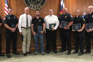 Katy Fire Chief Russell Wilson and Katy Mayor Bill Hastings recognized the life-saving efforts of private citizens and first responders at the July 8 Katy City Council meeting. From left are: equipment operator Justin Gray, Firefighter Bill Valenzuela, Hastings, Rees Williams Battalion Chief Jacob Duke, Capt. Chad Dismukes, Firefighter Devin Carriker, firefighter Christopher Edwards and Wilson.