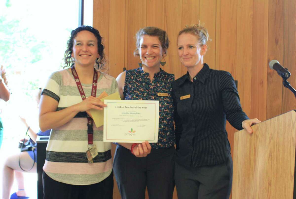 Jennifer Humphrey, a teacher at Nimitz Middle School, received the Secondary Teacher of the Year Award from EcoRise, an Austin-based nonprofit. Director of programs Abby Randall and Texas program manager Kristi Hibler-Lutton presented the award at the San Antonio Student Sustainability Showcase.