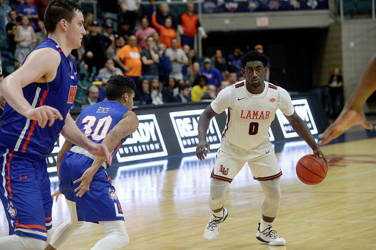 Lamar's Jordan Hunter brings the ball down court against Houston Baptist during their Southland tournament match-up Wednesday at the Merrell Center in Katy. Photo taken Wednesday, March 13, 2019 Kim Brent/The Enterprise