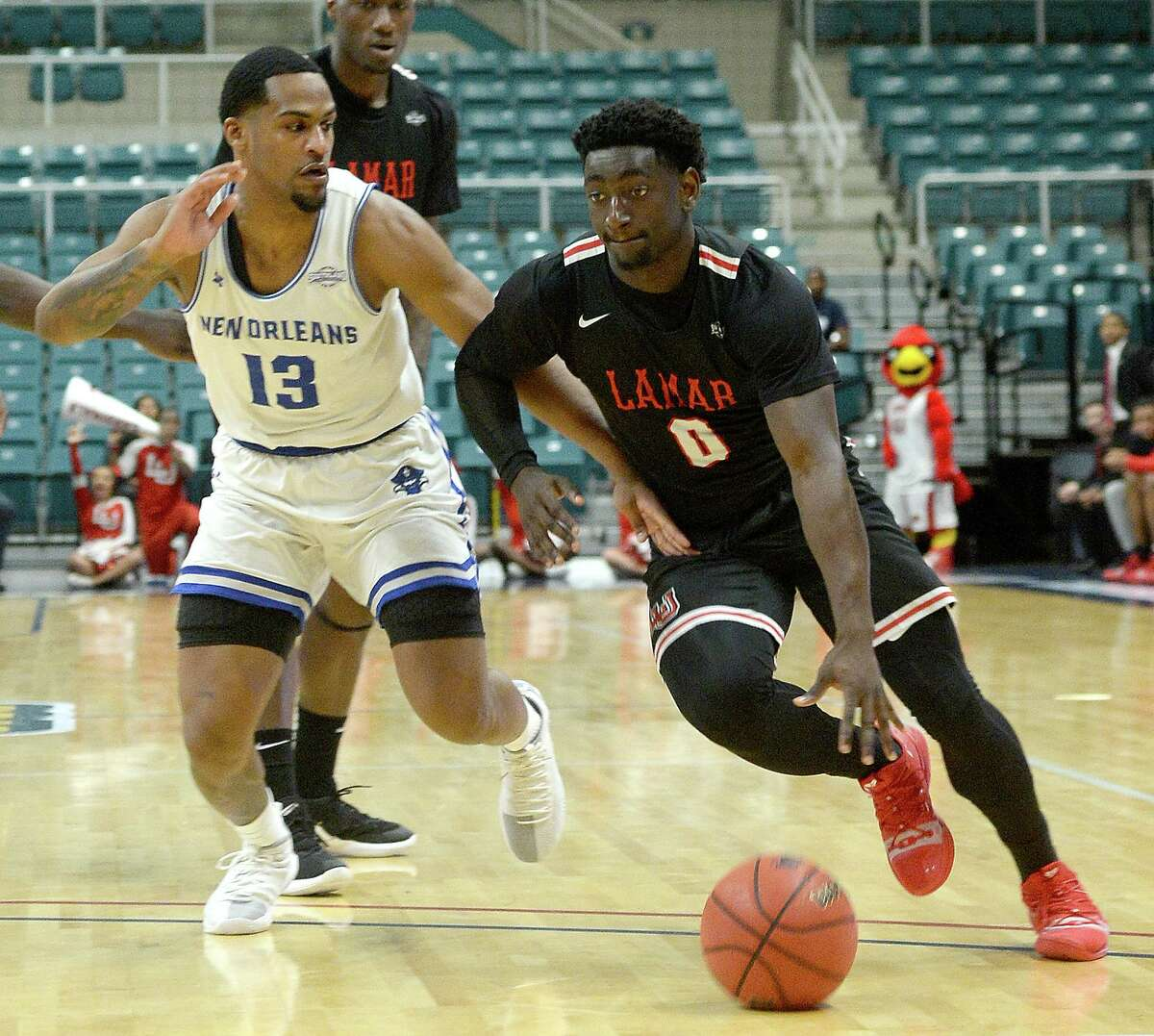 Lamar's Jordan Hunter drives against University of New Orleans' Jorge Rosa during their Southland tournament match-up Thursday at the Merrell Center in Katy. Photo taken Thursday, March 14, 2019 Kim Brent/The Enterprise