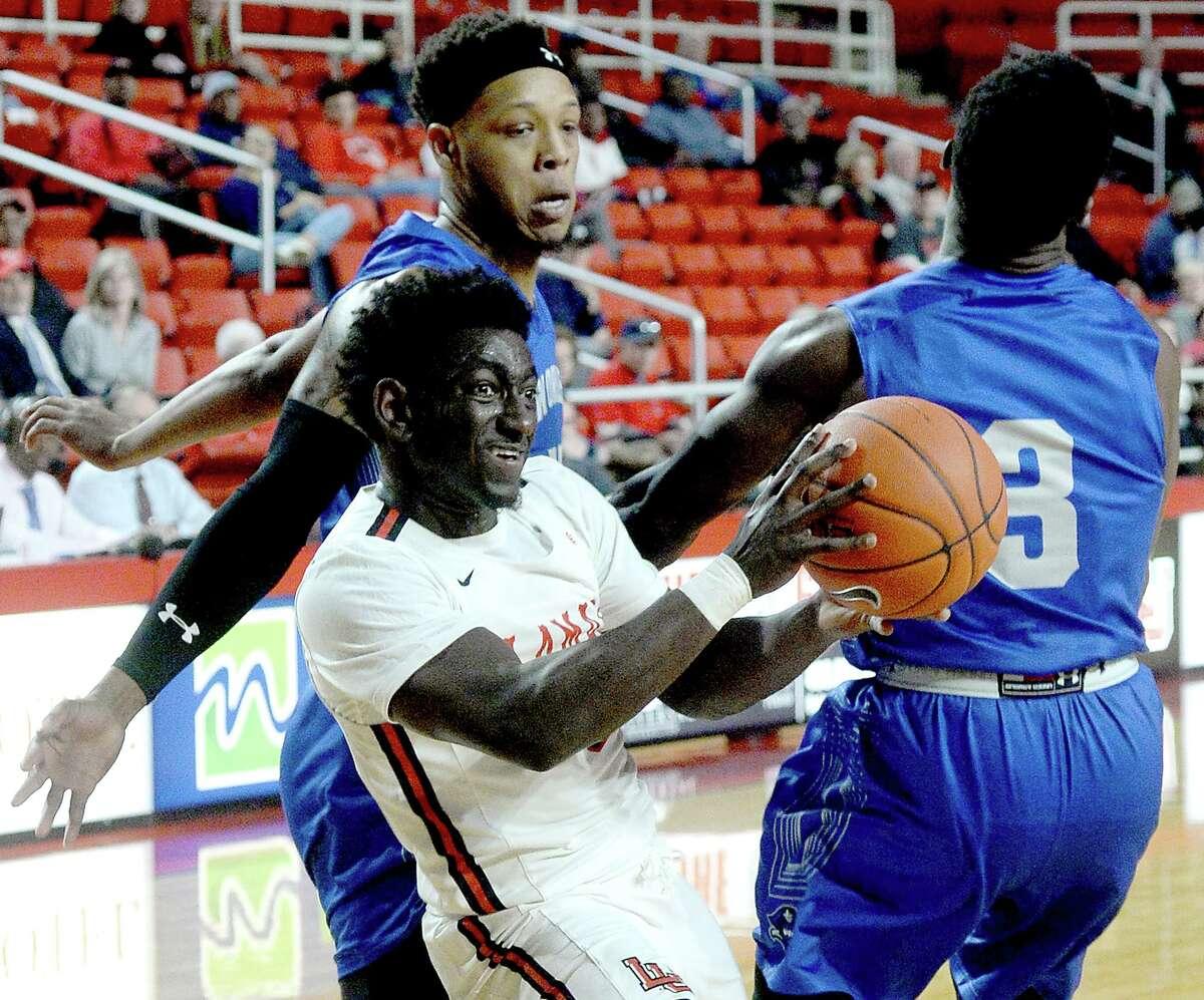 Lamar's Jordan Hunter looks to get off a shot against New Orleans' defense during their game Wednesday at the Montagne Center. Photo taken Wednesday, January 9, 2019 Photo by Kim Brent/The Enterprise