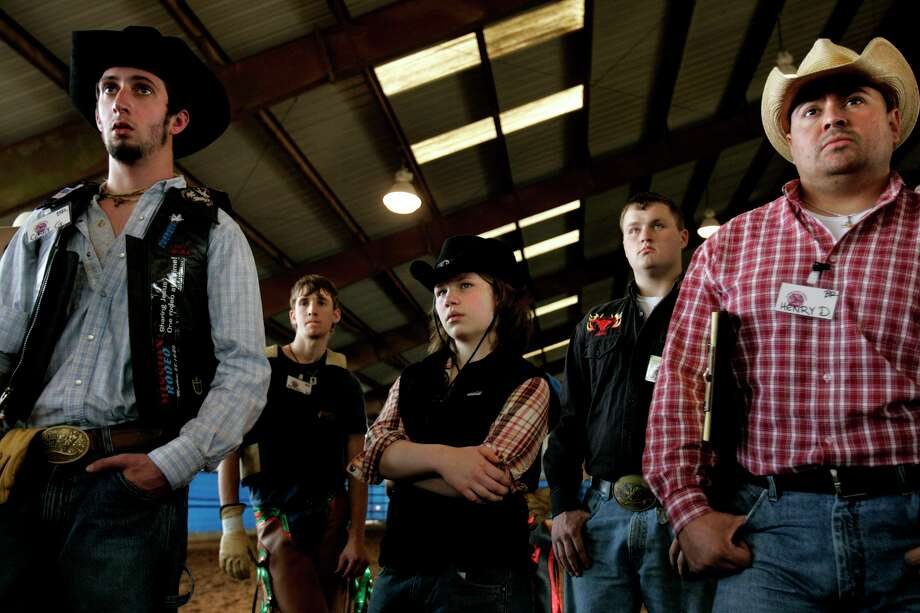 "A family-oriented All Girls Rodeo will be hosted for the first time by Cowboy World, Saturday at A.V. 'Bull' Sallas Park in New Caney. Maureen ""Mo"" Doyle, 15, listens with fellow rodeo school students at they receive instruction before their first STEER rides at the Sankey Rodeo School held in New Caney, TX on Saturday, Dec. 16, 2006. Photo: LISA KRANTZ, SAEN Staff / San Antonio Express-News / San Antonio Express-News"