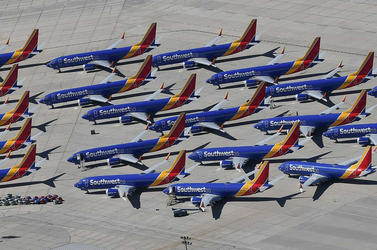 (FILES) In this file photo taken on March 28, 2019, Southwest Airlines Boeing 737 MAX aircraft are parked on the tarmac after being grounded, at the Southern California Logistics Airport in Victorville, California. - Boeing reported a sharp drop in second-quarter commercial plane deliveries on July 9, 2019 as the grounding of 737 MAX planes weighs on profits. Boeing, which has halted deliveries of the top-selling plane since mid-March, reported 90 deliveries in the quarter ending June, down from 194 in the year-ago period, a decline of 54 percent, with a big drop in 737 planes accounting for the difference. (Photo by Mark RALSTON / AFP)MARK RALSTON/AFP/Getty Images