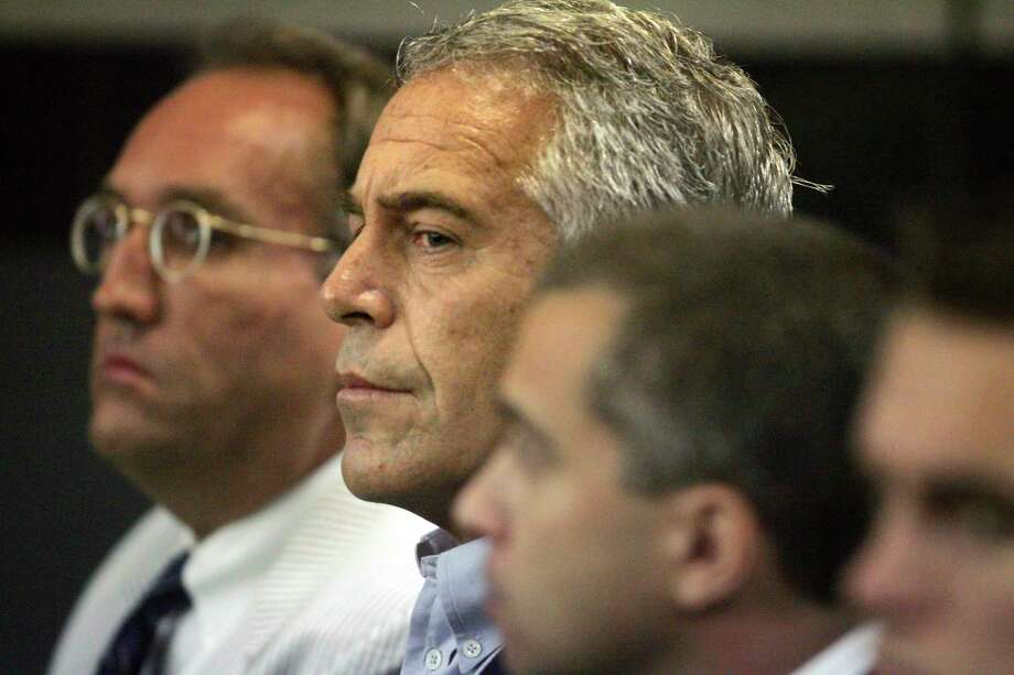 FILE - In this July 30, 2008, file photo, Jeffrey Epstein, center, appears in court in West Palm Beach, Fla. The wealthy financier pleaded not guilty in federal court in New York on Monday, July 8, 2019, to sex trafficking charges following his arrest over the weekend. Epstein will have to remain behind bars until his bail hearing on July 15. (Uma Sanghvi/Palm Beach Post via AP, File) Photo: Uma Sanghvi, AP / Palm Beach Post
