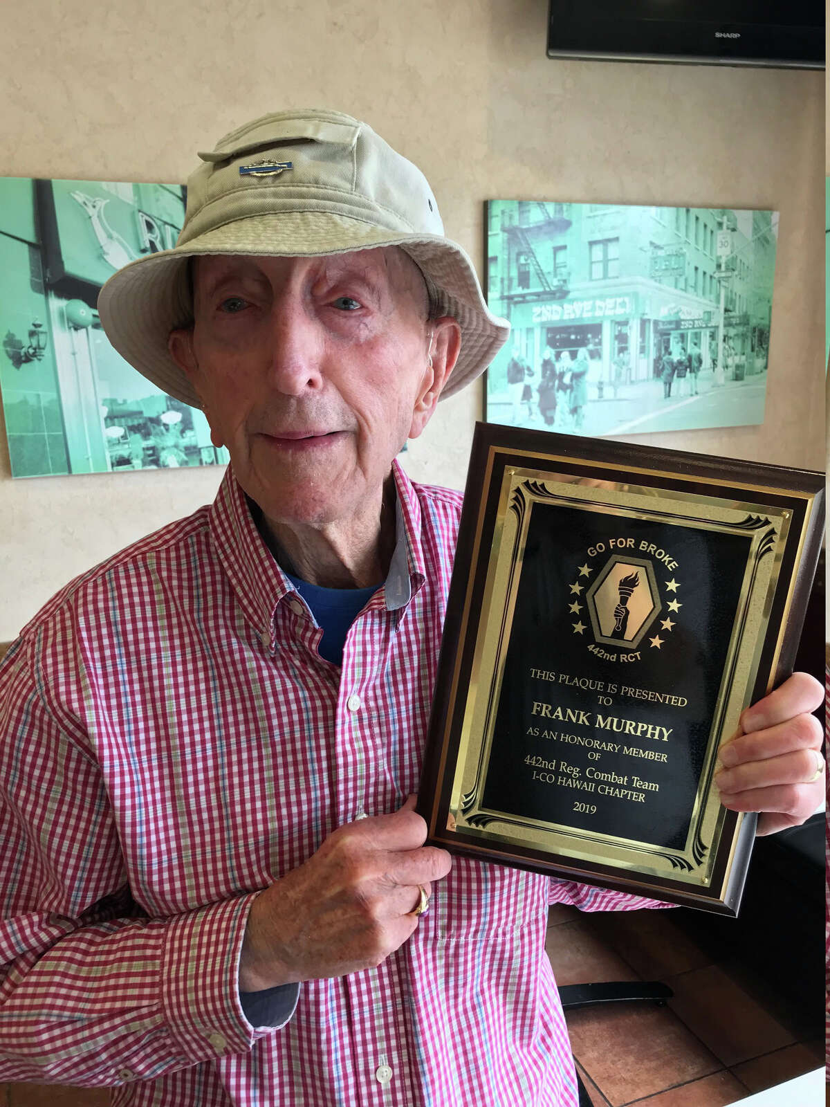 World War II veteran Frank Murphy was recently given this plaque as an honorary member of the 442nd combat unit, comprised of Japanese-Americans, whom he fought alongside in the Battle of Anzio.