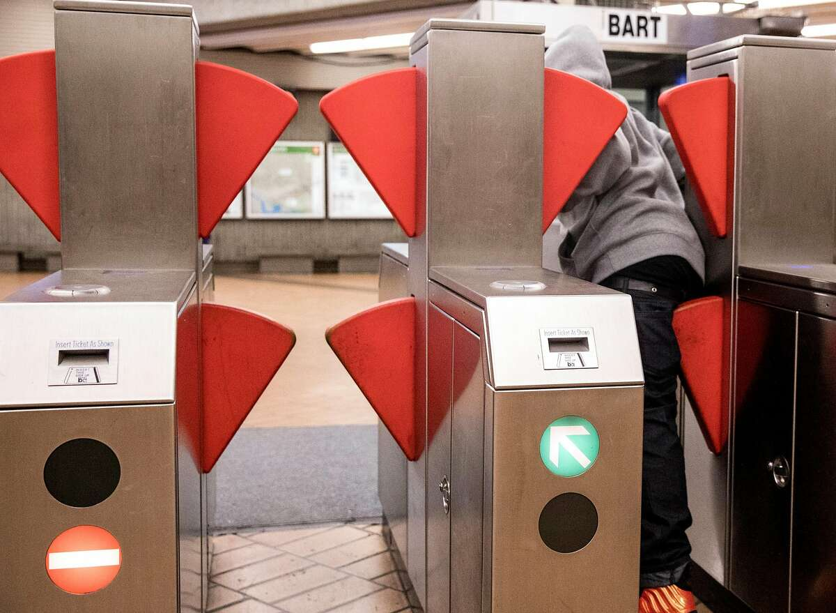 A fare evader forces his way through the new prototype fare gate at the Richmond BART Station in Richmond, Calif. Tuesday, July 9, 2019.