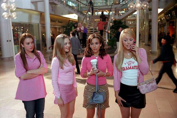 """Lindsay Lohan (from left) as Cady, Amanda Seyfried as Karen, Lacey Chabert as Gretchen and Rachel McAdams as Regina in """"Mean Girls."""" Paramount Pictures presents a Lorne Michaels Production, """"Mean Girls,"""" starring Lindsay Lohan, Rachel McAdams, Tim Meadows, Amy Poehler, Ana Gasteyer and Tina Fey. Directed by Mark Waters from a screenplay by Tina Fey, based on the book Queen Bees and Wannabes by Rosalind Wiseman, the film is produced by Lorne Michaels, executive produced by Jill Messick and co-produced by Louise Rosner. Paramount Pictures is part of the entertainment operations of Viacom Inc., one of the world's largest entertainment and media companies and a leader in the production, promotion and distribution of entertainment, news, sports and music. This film is rated PG-13 by the Motion Picture Association of America for sexual content, language and some teen partying. MG C1030-1 Photo by: Michael Gibson"""