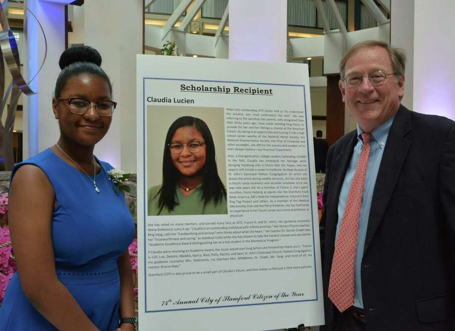Claudia Lucien, a high school senior in Stamford and participant in Future 5, catches up with Clif McFeely, who established the organization for Stamford students. Claudia was one of the winners of the Jewish War Veterans Community Service Award at the City of Stamford Citizen of the Year dinner this spring. Photo: Future 5 / Contributed Photo / Connecticut Post