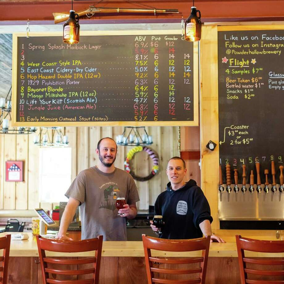 Powder Hollow Brewery will be opening up a second location off Main Street in Middletown at 62 Washington St. within the next three months. Shown at the Enfield location are head brewer Lance Boylan, left, and owner Michael Mcmanus. Photo: Contributed Photo