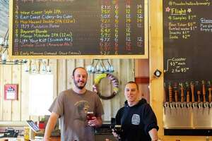 Powder Hollow Brewery will be opening up a second location off Main Street in Middletown at 62 Washington St. within the next three months. Shown at the Enfield location are head brewer Lance Boylan, left, and owner Michael Mcmanus.