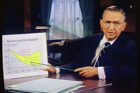 In this Oct. 16, 1992, photo, Ross Perot is shown on a screen in a paid 30-minute television commercial, during a media preview in Dallas. Perot, the Texas billionaire who twice ran for president, died Tuesday, July 9, 2019. He was 89.