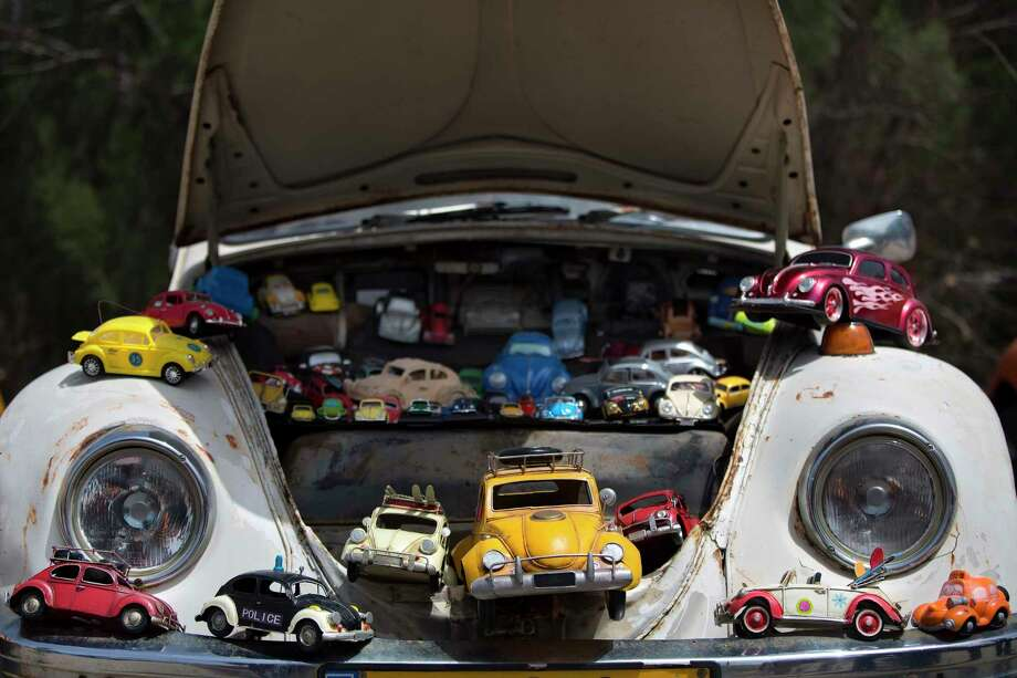 """FILE - In this April 21, 2017, file photo a collection of VW beetles car toys seen on Volkswagen Beetle displayed during the annual gathering of the """"Beetle Club"""" in Yakum, central Israel. Volkswagen is halting production of the last version of its Beetle model in July 2019 at its plant in Puebla, Mexico, the end of the road for a vehicle that has symbolized many things over a history spanning eight decades since 1938. (AP Photo/Oded Balilty) Photo: Oded Balilty, STF / Associated Press / Copyright 2019 The Associated Press. All rights reserved."""