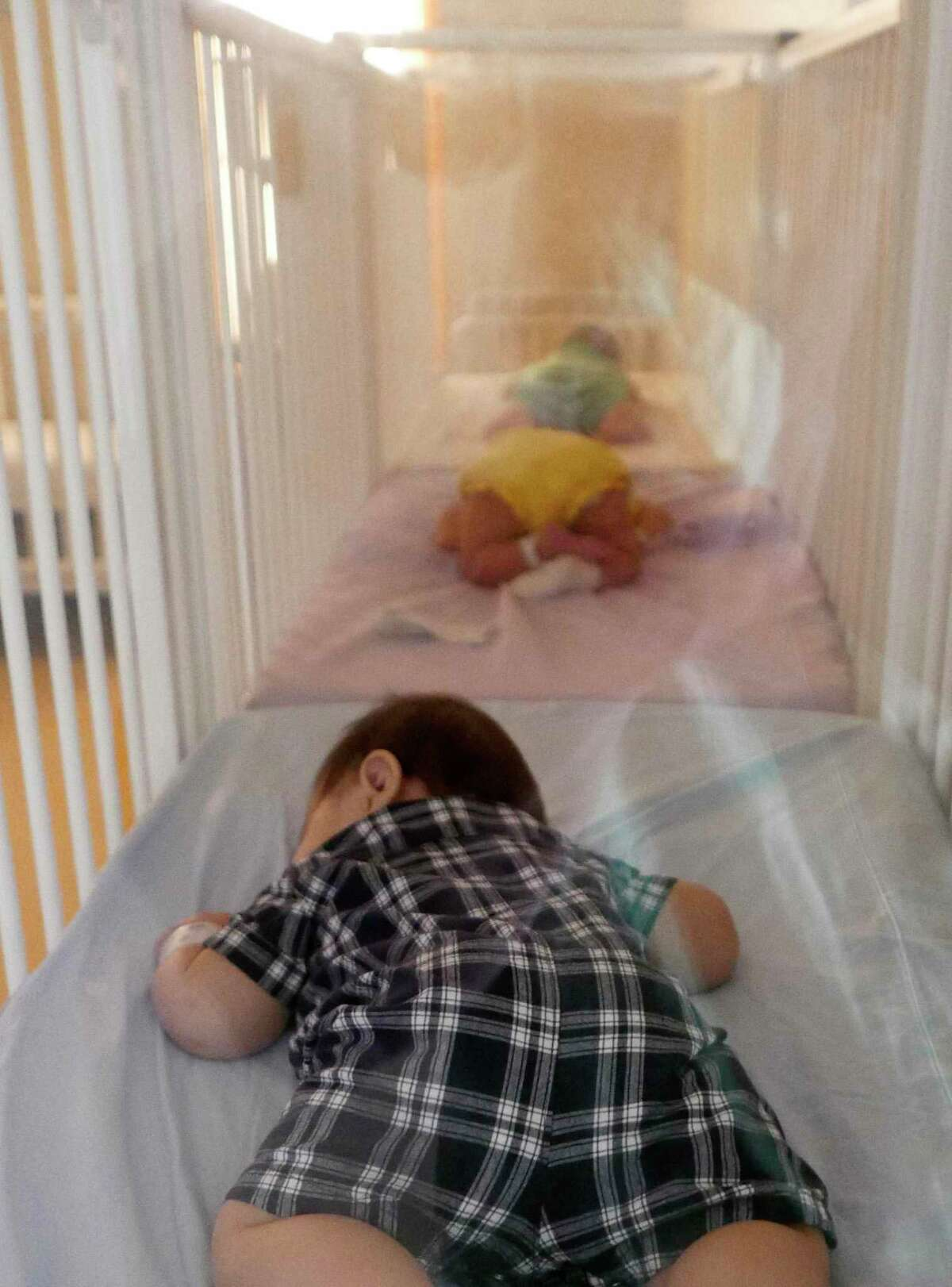 Babies sleep at nap time at the Children's Shelter of San Antonio on Tuesday, Aug. 21, 2018. The Texas Department of Family and Protective Services has awarded a major foster care contract to Family Tapestry, a division of the Children's Shelter of San Antonio.