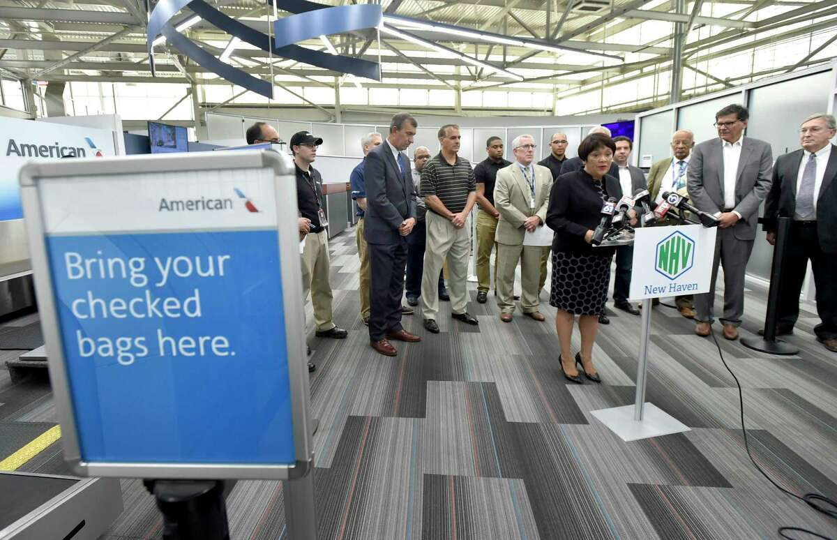 Then-New Haven Mayor Toni N. Harp, with city officials and New Haven-area business leaders, during a press conference at Tweed New Haven Regional Airport in 2019.