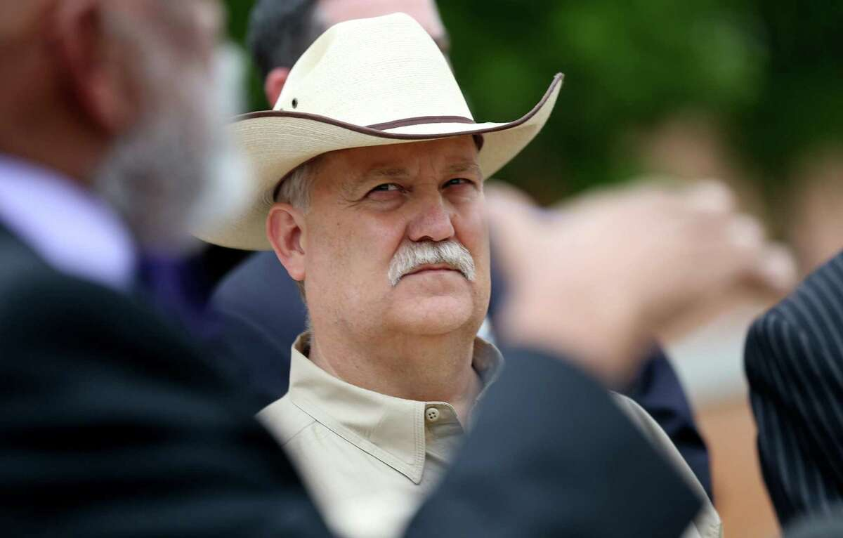 File photo shows then-Sheriff Glenn Smith listening to the Waller County Sheriff's Commission present its Recommended Police & Jail Practices report regarding the death of Sandra Bland on Tuesday, April 12, 2016, in Hempstead. Smith suffered a fatal heart attack on Aug. 1, 2020.