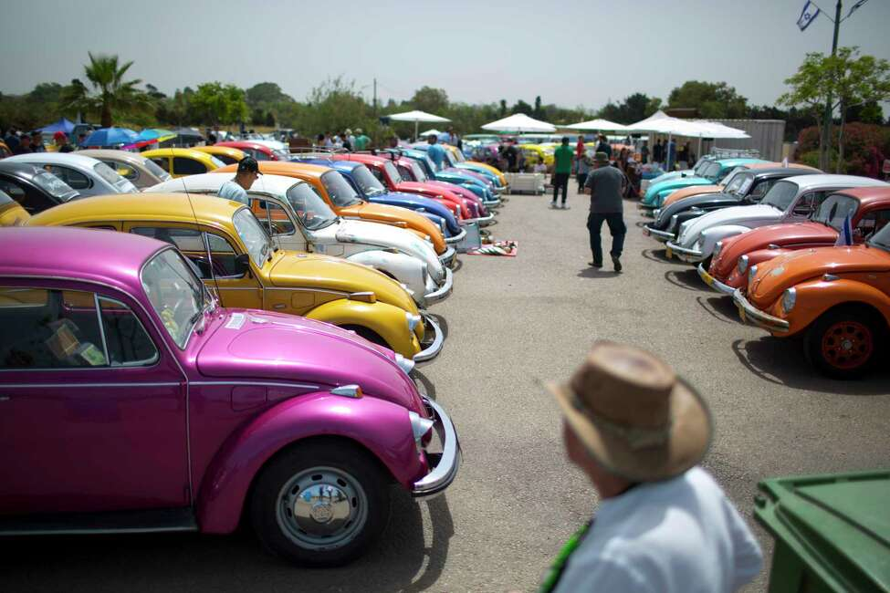 FILE - In this April 21, 2017, file photo Volkswagen Beetles are displayed during the annual gathering of the