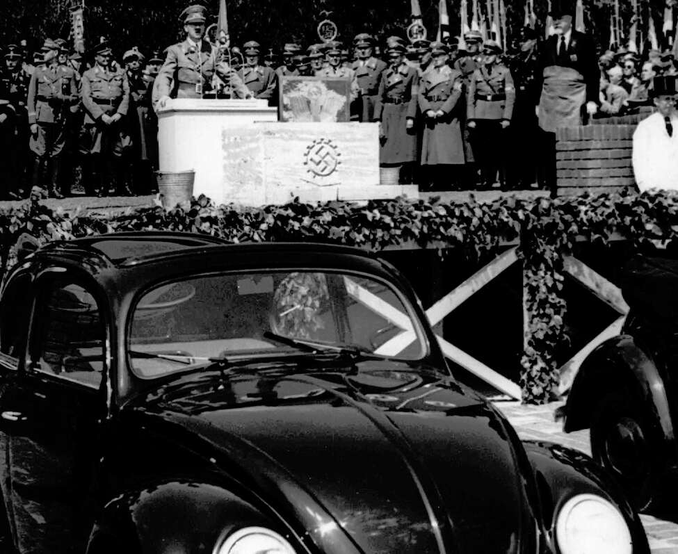 FILE - In this May 26, 1938 file photo, German Nazi leader Adolf Hitler speaks at the opening ceremony of the Volkswagen car factory in Fallersleben, Lower Saxony, Germany. Volkswagen is halting production of the last version of its Beetle model in July 2019 at its plant in Puebla, Mexico, the end of the road for a vehicle that has symbolized many things over a history spanning eight decades since 1938. (AP Photo, File)