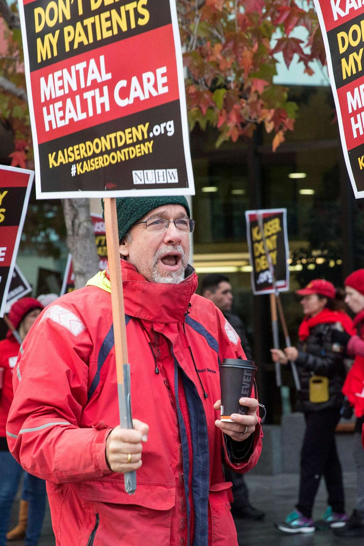 Sean Seward-Katzmiller, Marriage Family Therapist at Kaiser Permanente Santa Rosa Medical Center, protests outside Kaiser Permanente San Francisco Medical Center due to the contract dispute between workers' union, National Union of Healthcare Workers, and Kaiser. Monday, December 10, 2018 in San Francisco, Calif.