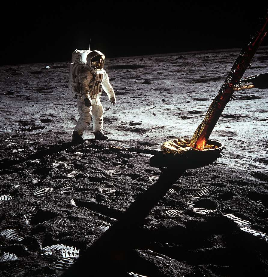 "Astronaut Edwin E. Aldrin Jr., lunar module pilot, walks on the surface of the moon near a leg of the Lunar Module during the Apollo 11 extravehicular activity (EVA). Astronaut Neil A. Armstrong, Apollo 11 commander, took this photograph with a 70mm lunar surface camera. The astronauts' bootprints are clearly visible in the foreground. While astronauts Armstrong and Aldrin descended in the Lunar Module (LM) ""Eagle"" to explore the Sea of Tranquility region of the moon, astronaut Michael Collins, command module pilot, remained with the Command and Service Modules (CSM) ""Columbia"" in lunar orbit. Photo: Nasa"