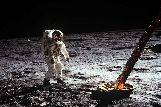 "Astronaut Edwin E. Aldrin Jr., lunar module pilot, walks on the surface of the moon near a leg of the Lunar Module during the Apollo 11 extravehicular activity (EVA). Astronaut Neil A. Armstrong, Apollo 11 commander, took this photograph with a 70mm lunar surface camera. The astronauts' bootprints are clearly visible in the foreground. While astronauts Armstrong and Aldrin descended in the Lunar Module (LM) ""Eagle"" to explore the Sea of Tranquility region of the moon, astronaut Michael Collins, command module pilot, remained with the Command and Service Modules (CSM) ""Columbia"" in lunar orbit."