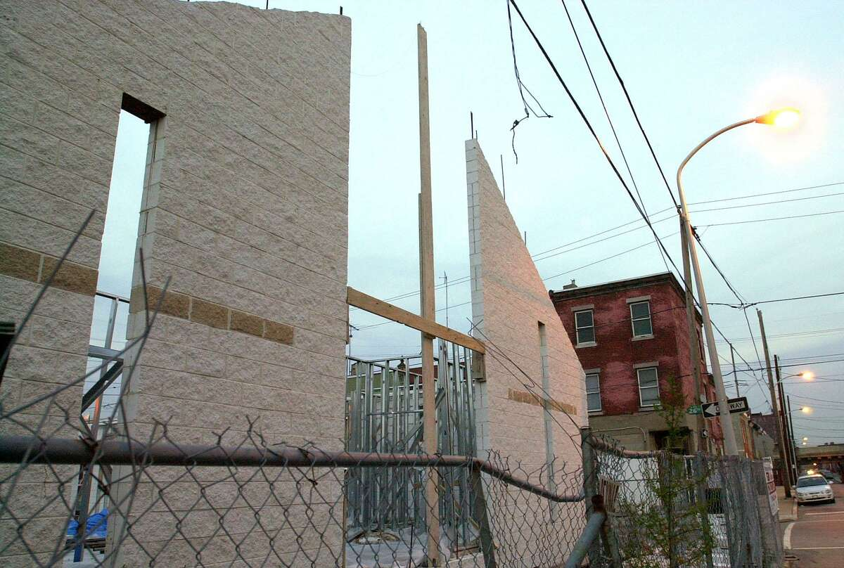 The Progressive Worship Center in South Philadelphia stands roofless and unfinished. Rev. Joe N. Mallory's congregation, which lost $9,000 in an investment scam by a charismatic ex-convict, is one of thousands of small black churches across the country to lose nearly $9 million.