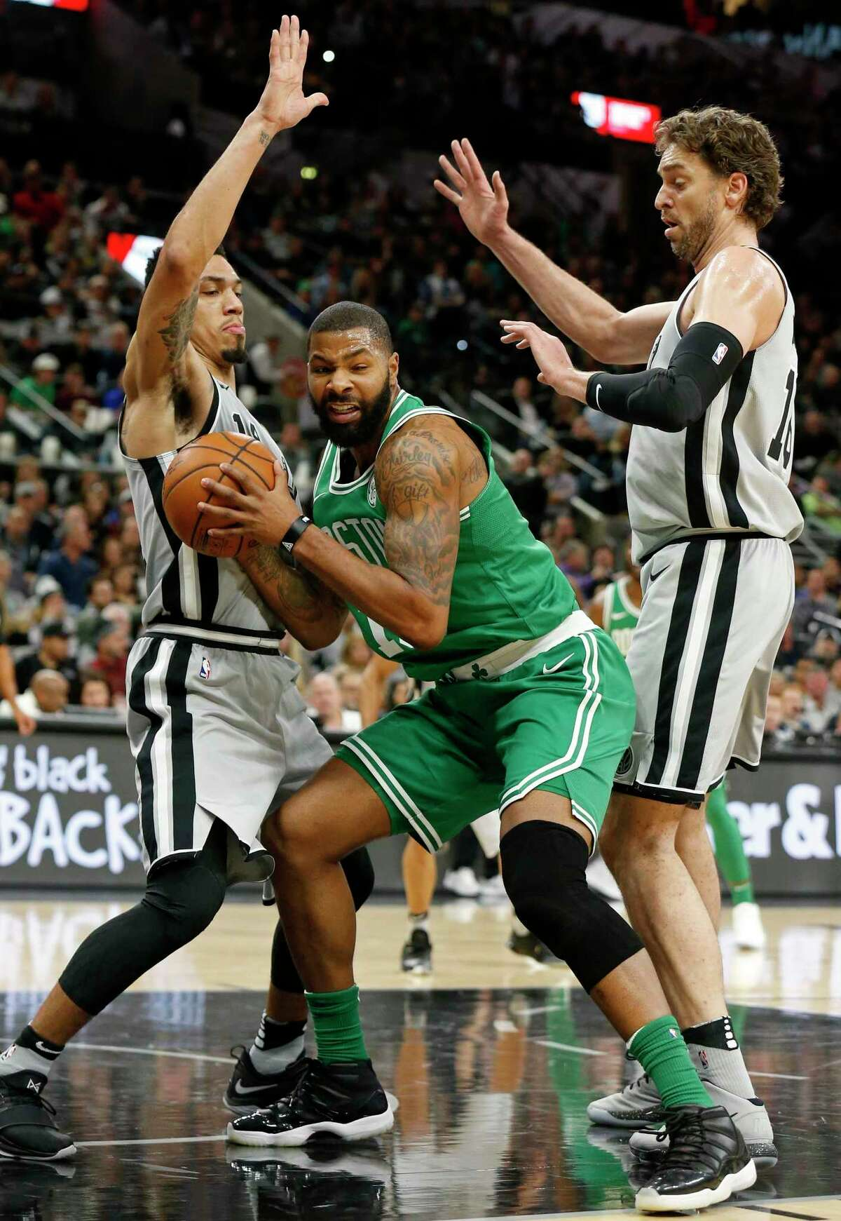 San Antonio Spurs guard Danny Green (14) and Pau Gasol (16) defend Boston Celtics forward Marcus Morris (13) during first half action Friday Dec. 8, 2017 at the AT&T Center.