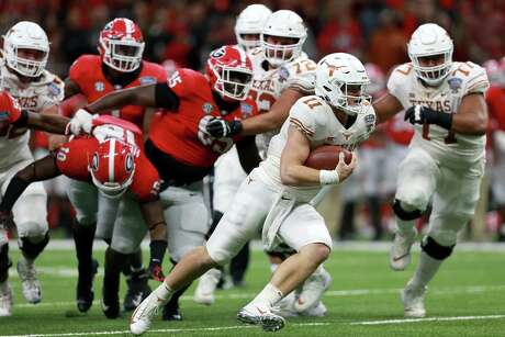 NEW ORLEANS, LOUISIANA - JANUARY 01: Sam Ehlinger #11 of the Texas Longhorns runs for a touchdown against the Georgia Bulldogs during the first half of the Allstate Sugar Bowl at the Mercedes-Benz Superdome on January 01, 2019 in New Orleans, Louisiana. (Photo by Sean Gardner/Getty Images)