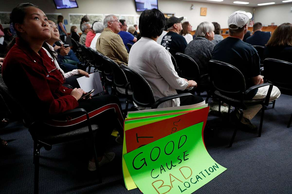 Caroline Xin listens to resident speakers during a meeting discussing possible locations for a homeless navigation center at City Council chambers in Fremont, Calif., on Tuesday, July 9, 2019. Fremont is considering locations to open a new navigation center in their city for the homeless. In September, the council will determine one specific location for the center-- which will house Fremont residents and other Alameda County residents. Residents agree that the city should do more to help the homeless, as long as its