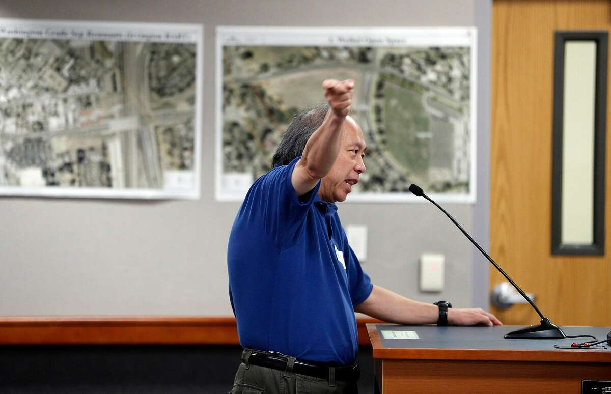 Fremont resident Hiu Ng gives his comment during a meeting discussing possible locations for a homeless navigation center at City Council chambers in Fremont, Calif., on Tuesday, July 9, 2019. Fremont is considering locations to open a new navigation center in their city for the homeless. In September, the council will determine one specific location for the center-- which will house Fremont residents and other Alameda County residents. Residents agree that the city should do more to help the homeless, as long as its