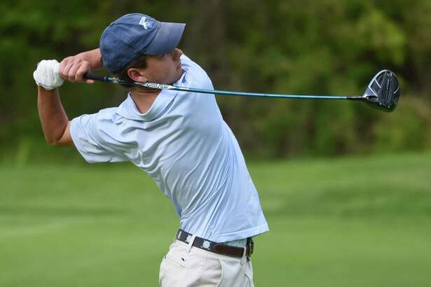 Darien's Calvin Smith tees off on the ninth during the Blue Wave's boys golf match against rival New Canaan at the Country Club of New Canaan on Wednesday, May 15, 2019.