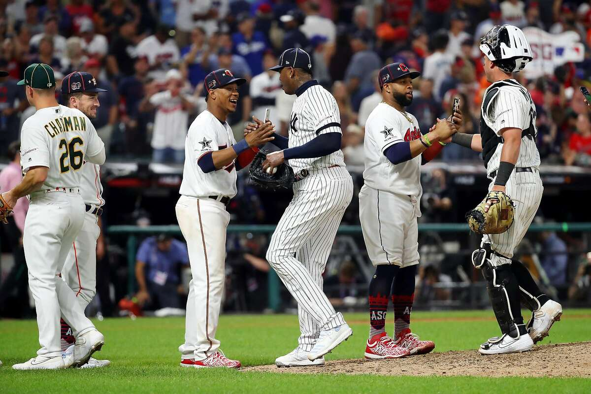 CLEVELAND, OHIO - JULY 09: The American League All-Stars celebrate defeating the National League All-Stars 4-3 in the 2019 MLB All-Star Game, presented by Mastercard at Progressive Field on July 09, 2019 in Cleveland, Ohio. (Photo by Gregory Shamus/Getty Images)