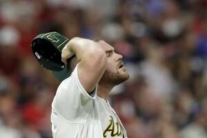 American League pitcher Liam Hendriks, of the Oakland Athletics, reacts after giving up a solo home run to National League Charlie Blackmon, of the Colorado Rockies, during the sixth inning of the MLB baseball All-Star Game, Tuesday, July 9, 2019, in Cleveland. (AP Photo/Tony Dejak)