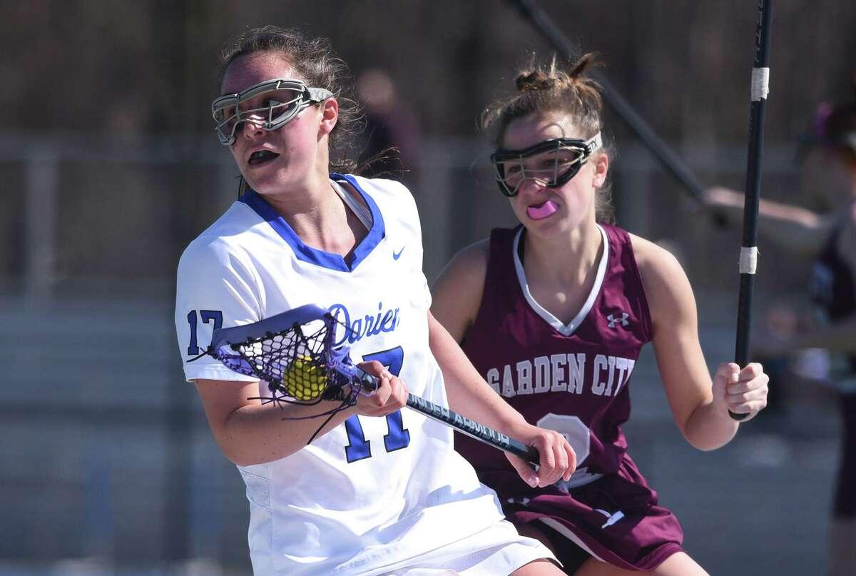 Darien's Sarah Jaques (17) controls the ball while Garden City's Amanda Cerrarto (2) defends during a girls lacrosse game at Darien High School on Saturday, April 6.