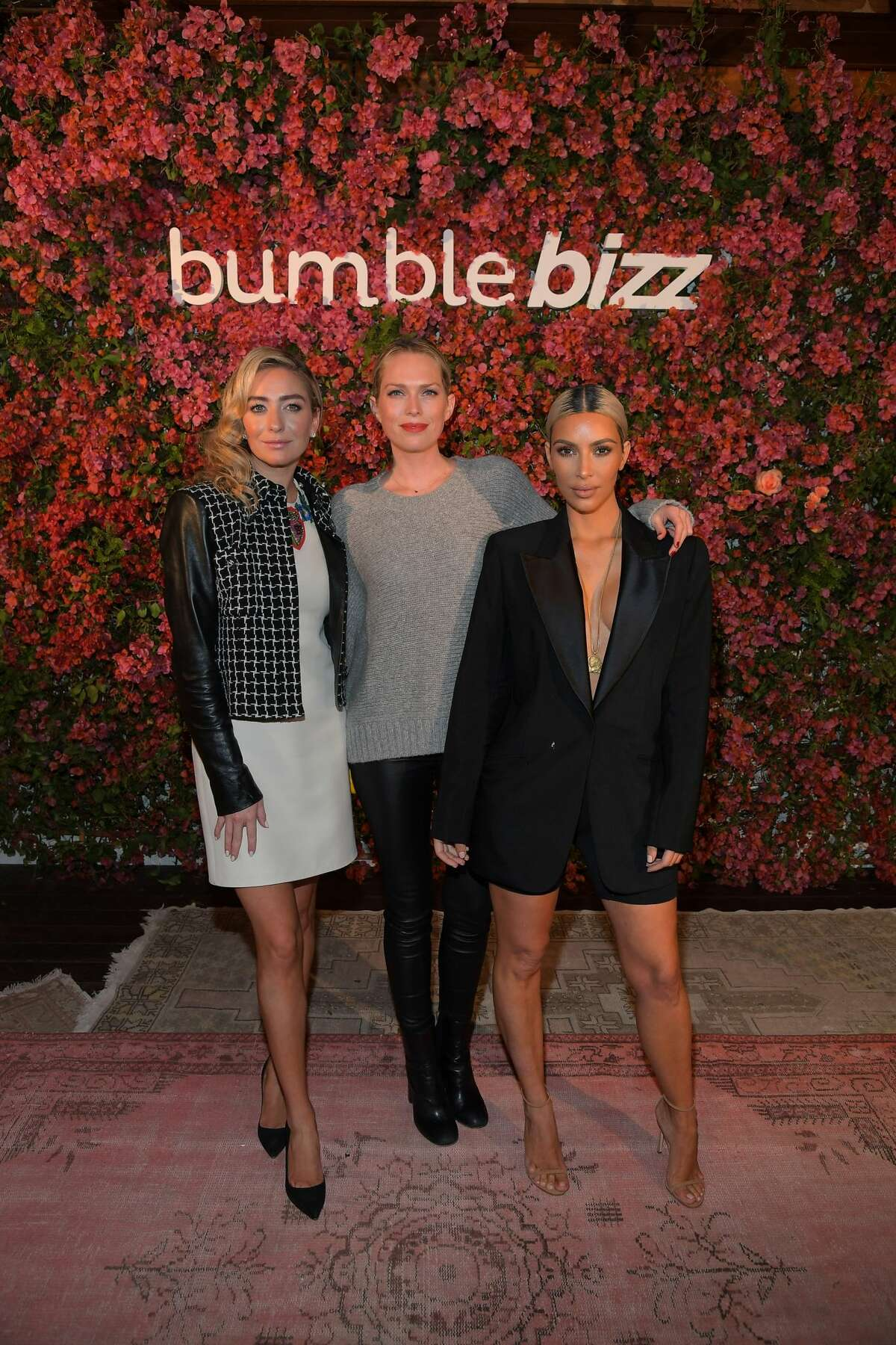 Whitney Wolfe Herd, Erin Foster, and Kim Kardashian attend Bumble Bizz Los Angeles Launch Dinner At Nobu Malibu at Nobu Malibu. Herd is known for living a lavish lifestyle and is regularly photographed with celebrities.