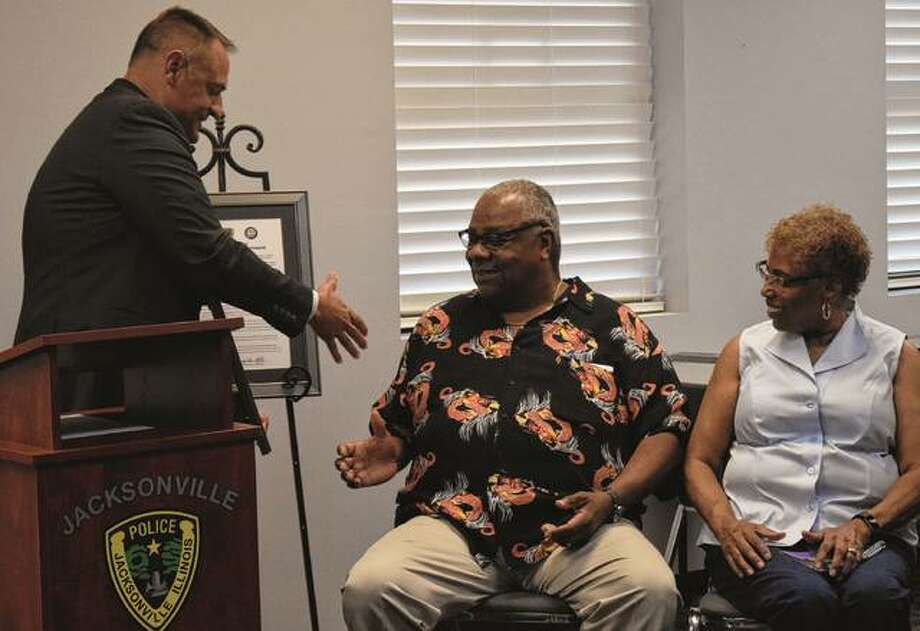 Jacksonville Police Chief Adam Mefford (left) shakes hands Tuesday with Eric Robinson and Doris Robinson during the signing of an Affirmation of Shared Principles at Jacksonville Police Department. Photo: Samantha McDaniel-Ogletree | Journal-Courier