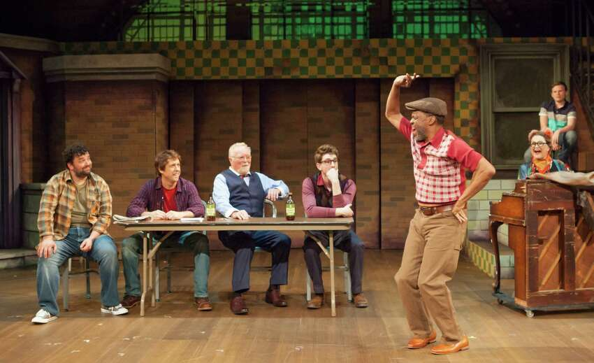 Reggie Whitehead, standing, and other cast members of