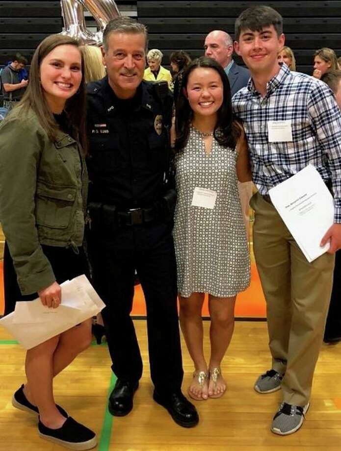 Award winners of this year's Ridgefield Police Benevolent Association Scholarship, from left to right: Emma Brody, Officer Fernando Luis, Grace Preston and Benjamin Riek. Photo: Ridgefield Police Department / Facebook