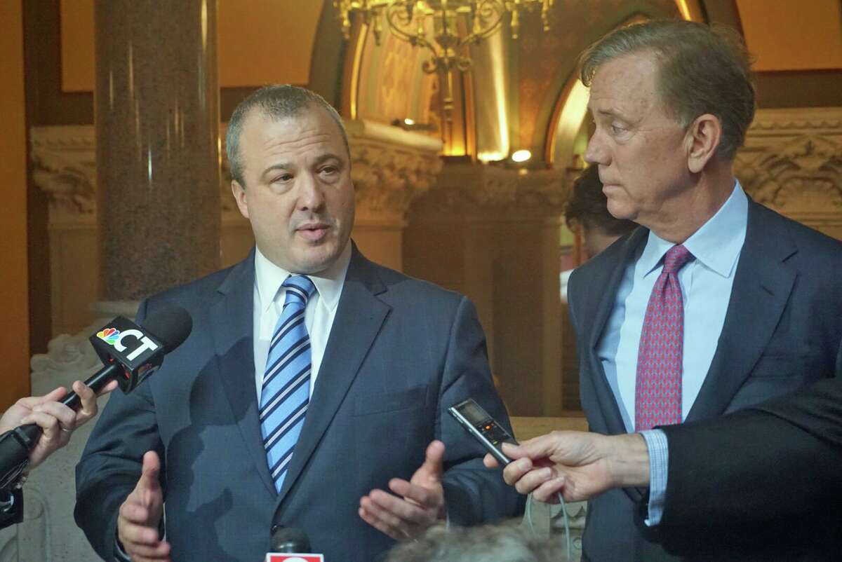 Jonathan Harris (left) is part of a shake-up in Gov. Ned Lamont;s administration.