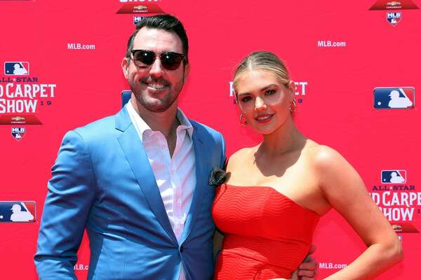CLEVELAND, OH - JULY 09: Justin Verlander #35 of the Houston Astros poses for a photo with his wife Kate Upton during the MLB Red Carpet Show presented by Chevrolet at Progressive Field on Tuesday, July 9, 2019 in Cleveland, Ohio. (Photo by Adam Glanzman/MLB Photos via Getty Images)