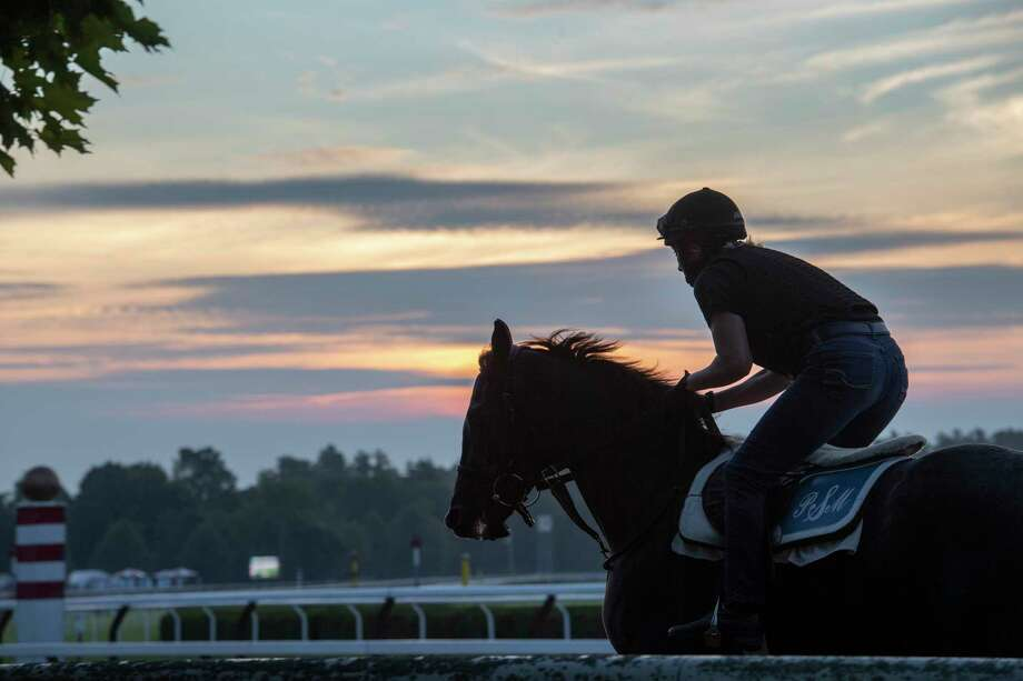 A horse from the Phil Serpe training stable gallops goes out for exercise as the sun rises on the Saratoga Race Course Wednesday, July 10, 2019 in Saratoga Springs, N.Y.  The 2019 meeting of the Saratoga Race Course begins July 11th.   Special to the Times Union by Skip Dickstein Photo: SKIP DICKSTEIN / ©Skip Dickstein 2019
