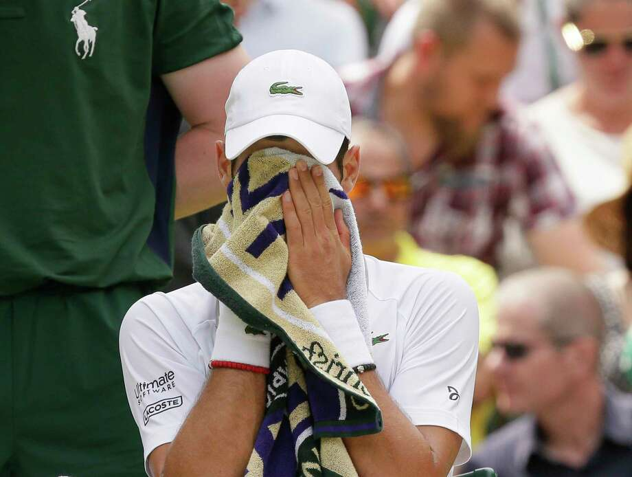 Serbia's Novak Djokovic wipes his face during a men's quarterfinal match against Belgium's David Goffin on day nine of the Wimbledon Tennis Championships in London, Wednesday, July 10, 2019. Photo: Tim Ireland, AP / Copyright 2019 The Associated Press. All rights reserved